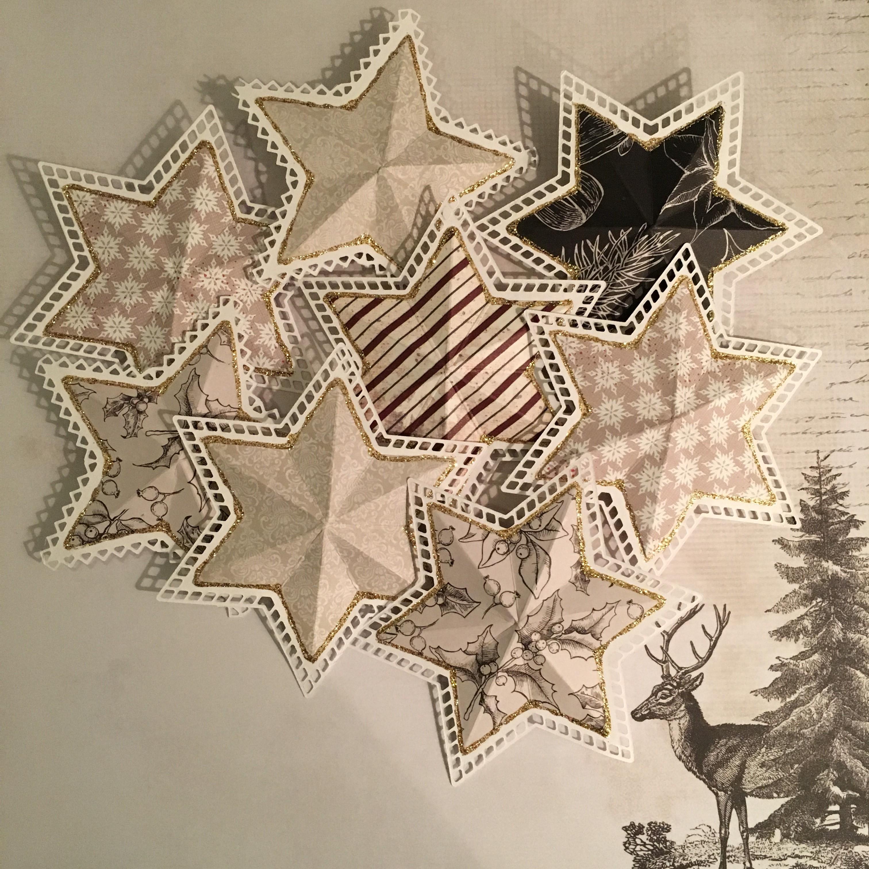 Julestjerner og lyshuse i lækkert mønsterpapir